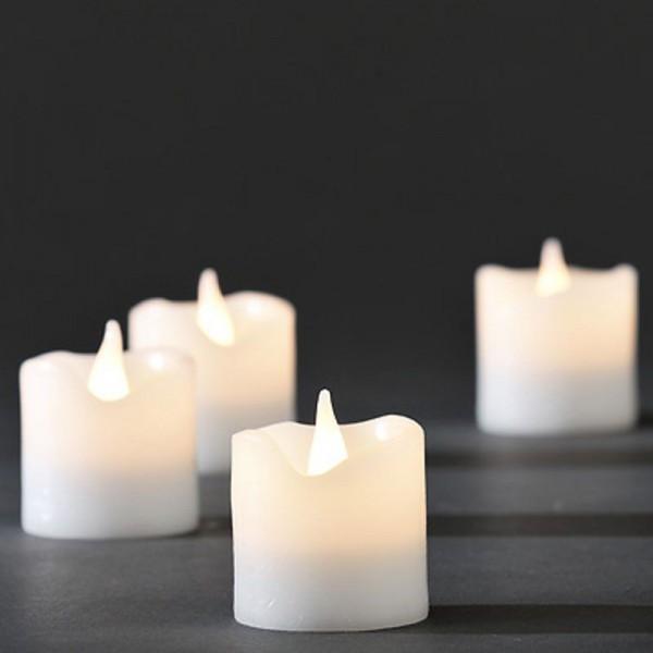 Konstsmide 4er-Set LED Echtwachs-Kerzen weiß batteriebetrieben
